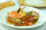 "Coral Sea ""Bouillabaisse"" served with Julienne vegetables and Parmesan Tuille"