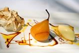 Saffron Poached pear with syrup and caramel sauce, ilo wafer and double King Island cream
